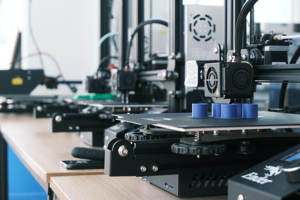 several 3D printers