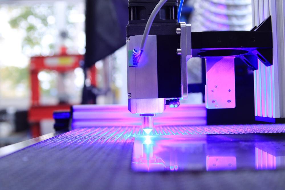 Alt-text: a laser cutting machine