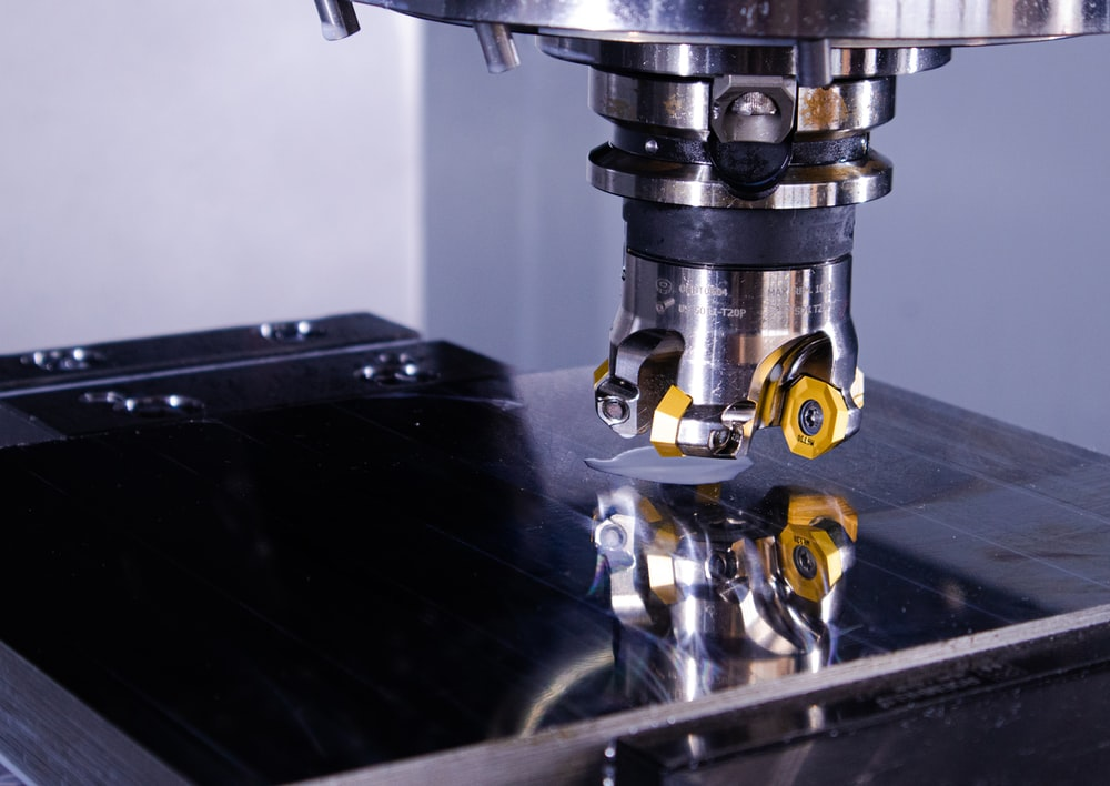 a milling machine on steel surface